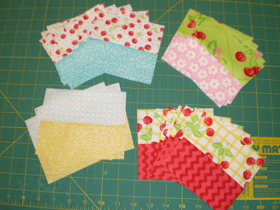 Parts of blocks are ready to stitch together to make Sherri's jelly roll placemats (tutorial on her blog)