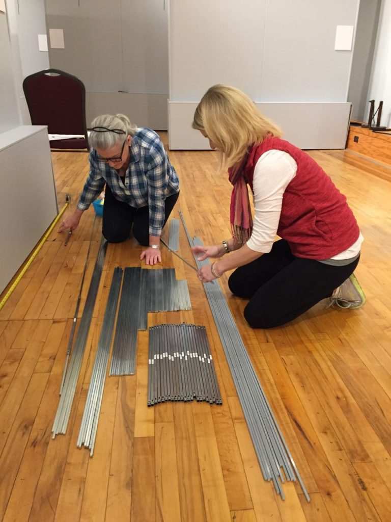 On Jan. 25, Marianne and Megan sorted the hanging rods in preparation for the new show.